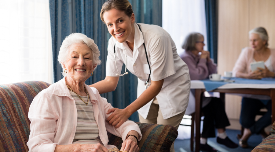 Nurse caring for a resident in a nursing home